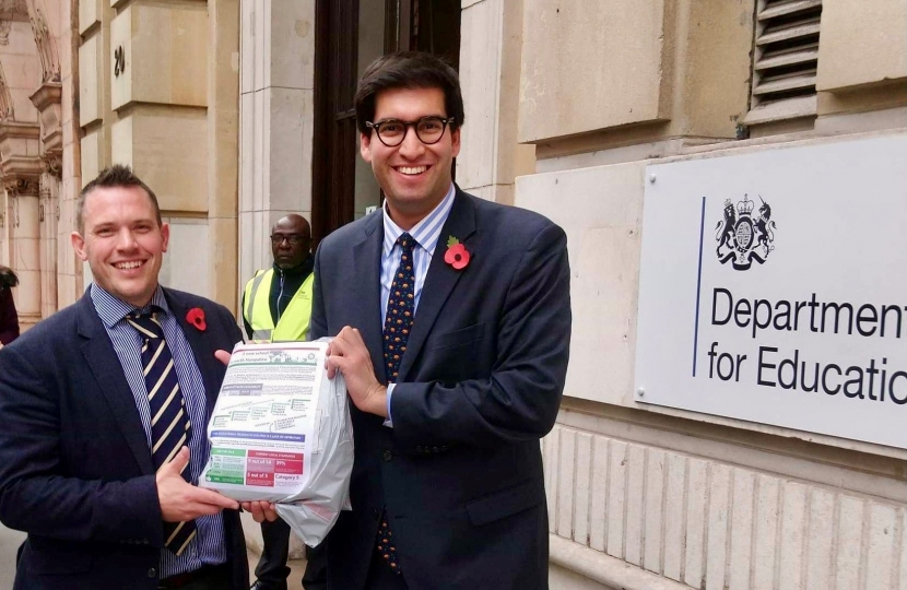 Ranil Jayawardena MP (right) and Revd Dr Chris Evans handing in their application at the Department for Education.