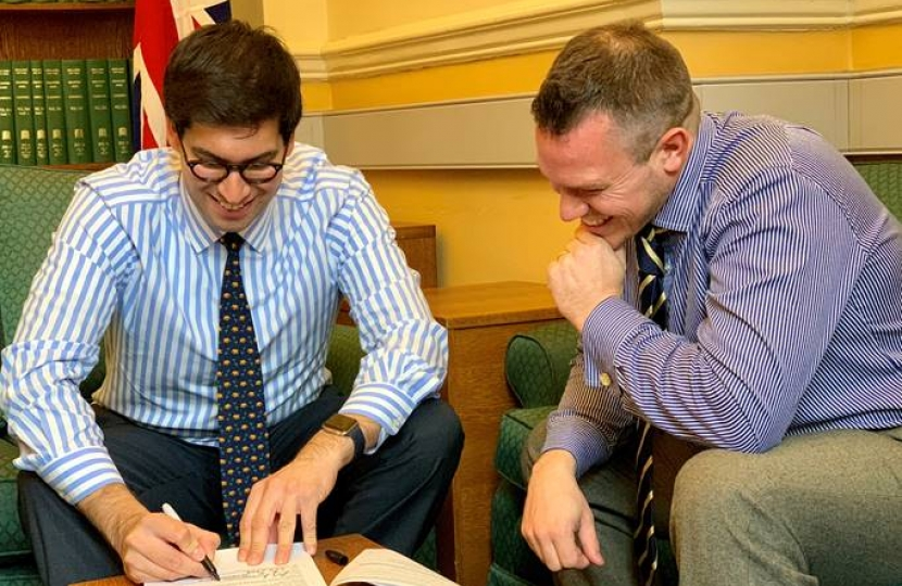 Ranil Jayawardena MP (left) and Revd Dr Chris Evans finishing and signing their application.